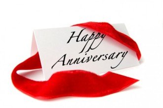 Image of Happy Anniversary card and red ribbon